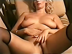 My sexually lascivious golden-haired wife on the sofa masturbating connected with solo