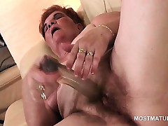 Unsettled mature BBW pleasing mortal physically with a big dildo