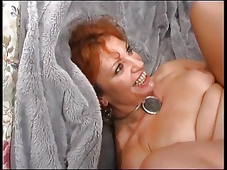 Mature Redhead Enjoys Young Cock