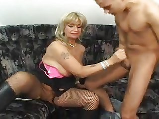 Slutty Granny in parlour-maid plus stockings is an escort