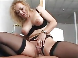 Nice mart granny in stockings fucks a younger suppliant