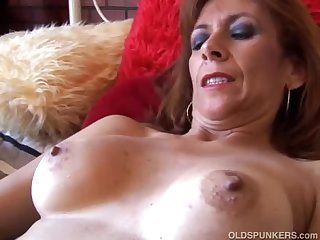 Gorgeous mature redhead is tune horny