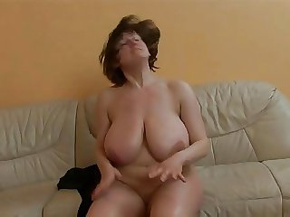 Full-grown lady with really huge boobs obtaining fucked