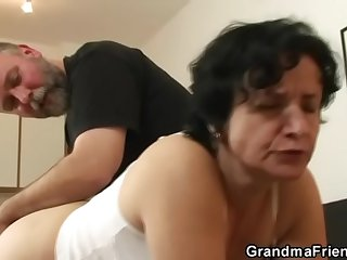 Granny in blanched lingerie swallowing two cocks after pussy toying