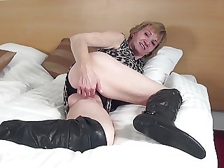 Dabbler granny with stimulated old cunt in big coal-black boots