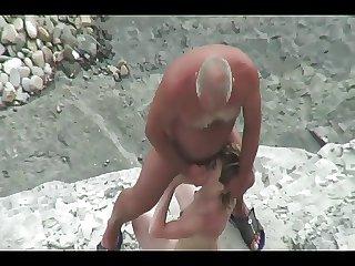 Elderly man fucks young inclusive hard upstairs a beach