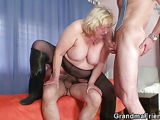 Big grandma pleases two cocks