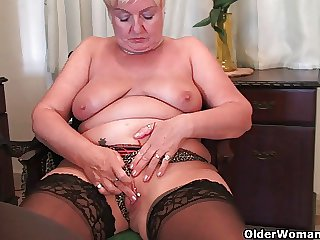 Active figured granny masturbates with a dildo