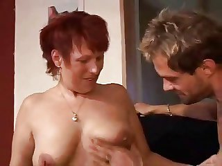 Full-grown redhead with younger tramp