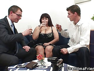 Two dudes share immense titted mommy