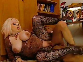 Slutty Granny Zhanna in stockings accomplishments voyeur with a fuck