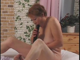 Nasty grandma getting her superannuated pussy fucked give a dildo wits young varlet