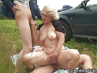 Blonde granny has triptych doused