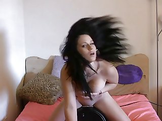 Mia's succulent knockers bounce while she rides a fuck machine