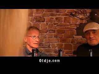 Daring blonde sucks two elderly dicks