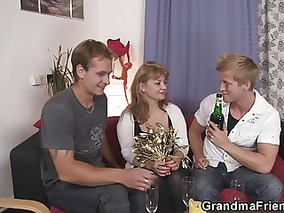 Adult babe in stockings takes two cocks at once