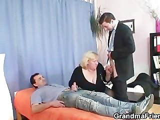 Granny takes two cocks at once