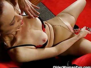Classy mature lady around pantyhose gives her pussy a squeamish