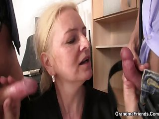 Shrunken granny blonde takes two cocks