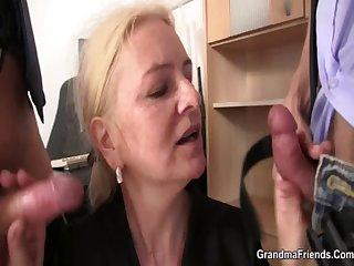 Shrunken granny blonde takes two cocks